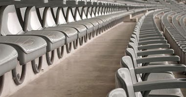 Many empty seats in a sports arena.