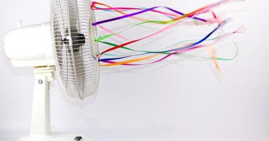 An electric fan blowing colorful silk ribbons
