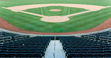 Baseball stadium with seating and a baseball diamond with green grass