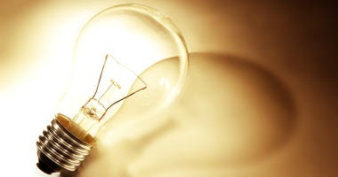 Light bulb and shadow, warm tone
