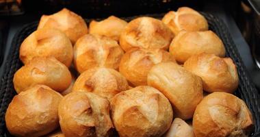 A warm, crusty dinner roll on a Basket.