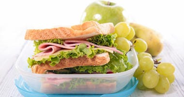 Lunch box on wood background