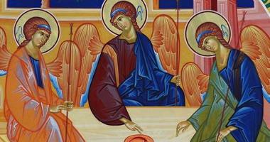 Orthodox church. Wall painting with the Holy Trinity - Bujoreni Monastery, Vaslui County, landmark attraction in Romania.