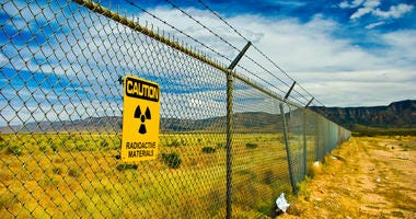 Radioactivity Warning sign saying Radioactive Materials on a fence surrounding the Trinity Site in New Mexico where the very first nuclear bomb was assembled, tested and exploded.