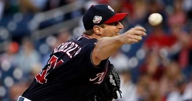 Washington Nationals starting pitcher Max Scherzer throws