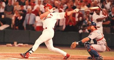 St. Louis Cardinals' Mark McGwire follows through with his 62nd home run of the season breaking Roger Maris' 37-year-old record.