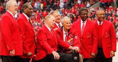 St. Louis Cardinals Hall of Famers, from left, Bruce Sutter, Bob Gibson, Red Schoendienst, Whitey Herzog, Stan Musial, Lou Brock, and Ozzie Smith pose during the opening day ceremony on Friday, April 13, 2012, at Busch Stadium in St. Louis, Missouri, agai