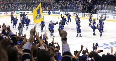 St. Louis Blues players acknowledge the fans