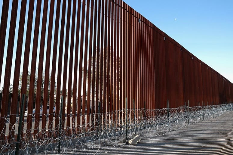 A steel and concertina wire barrier runs along the border of the United States and Mexico on January 26, 2019 in Calexico, California. The U.S. government had been partially shut down as President Donald Trump battled congress for $5.7 billion in funding