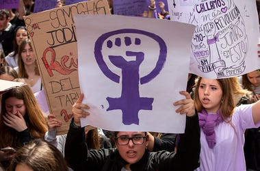 MARCH 08: A student holds a placard with feminist symbol during protest along the streets during the International Women's Day on March 08, 2019 in Madrid, Spain. Spain celebrates International Women's Day today with a women's general strike and countless