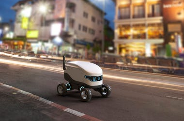 Self-driving delivery robot concept. 3D illustration