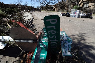 A fallen street sign in the Preston Hollow neighborhood on October 21, 2019 in Dallas, Texas. A tornado struck Sunday night causing major damage to homes, businesses and schools but no deaths or serious injuries have been reported.