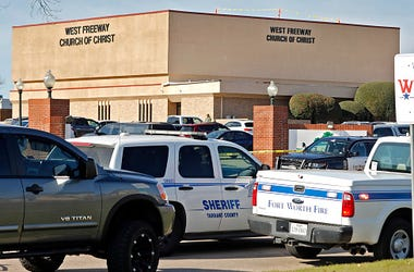 Law enforcement vehicles are parked outside West Freeway Church of Christ where a shooting took place at the morning service on December 29, 2019 in White Settlement, Texas. The gunman was killed by armed members of the church after he opened fire during