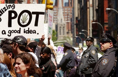 "Hundreds of pro-cannabis demonstrators march May 4, 2002 in New York City. The marchers, who advocate for the legalization of cannabis, were part of almost 200 similar events planned around the world May 4 under the name of the ""Million Marijuana March""."