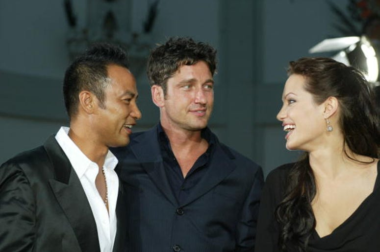 "Actors Simon Yam, Gerard Butler and Angelina Jolie attend the world premiere of the film ""Lara Croft Tomb Raider: The Cradle of Life"" at Grauman's Chinese Theatre July 21, 2003 in Hollywood, California. The film releases nationwide July 25, 2003."
