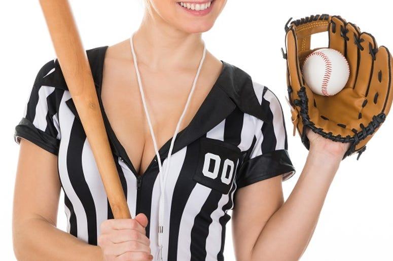 Young Beautiful Referee Wearing Baseball Glove And Holding Baseball Bat