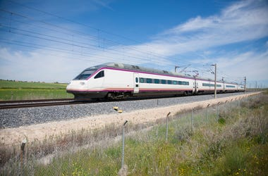 railway with high speed train at a landscape