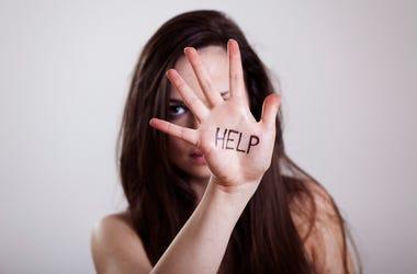 HELP written on hand.HELP written on hand.