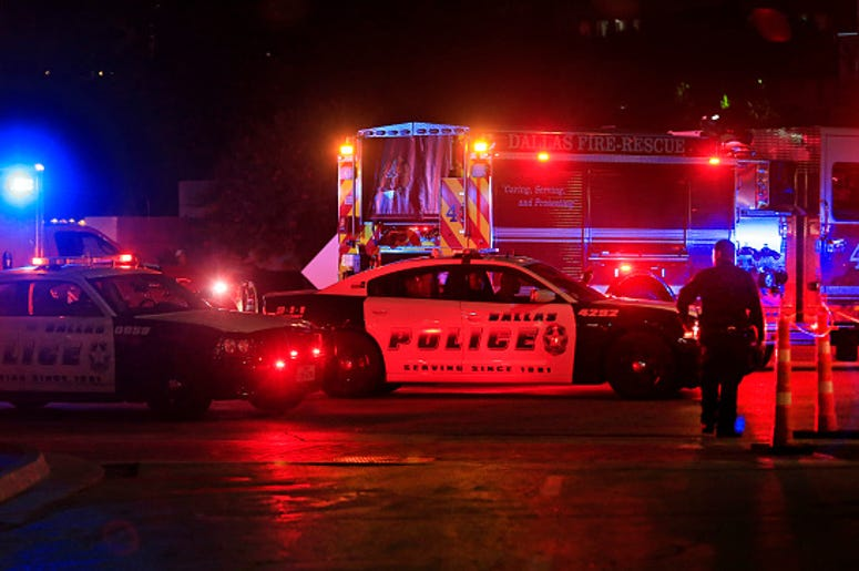 Dallas police work near the scene where eleven Dallas police officers were shot and five have now died on July 8, 2016 in Dallas, Texas. According to reports, shots were fired during a protest being held in downtown Dallas in response to recent fatal shoo
