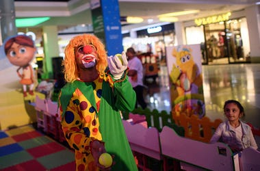 A clown entertains children in a shopping mall on October 25, 2016 in Erbil, Iraq. As the offensive by Iraqi and Kurdish forces to drive Islamic State out of Iraq's second largest city of Mosul continues and despite a recent ISIS attack on nearby Kirkuk,