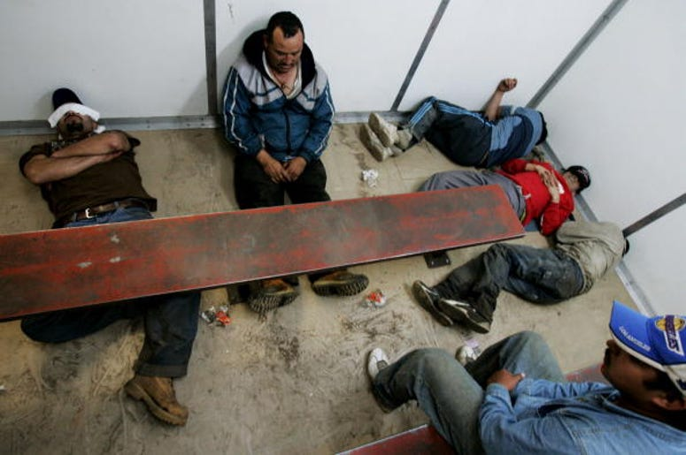 Illegal immigrants sit in a Customs and Border Patrol detention facility after being detained October 17, 2007 in Campo, California. Many states far from the border are having to confront illegal immigration issues like never before as the flow of migrant