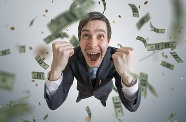 Young successful businessman win a lot of money.