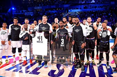 Team Lebron guard Dwayne Wade of the Miami Heat (3) and Team Giannis forward Dirk Nowitzki of the Dallas Mavericks (41) are honored during the 2019 NBA All-Star Game at Spectrum Center.