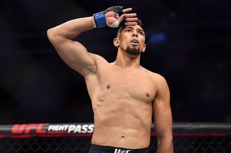 Johnny Walker (blue gloves) defeats Misha Cirkunov (red gloves) during UFC 235 at T-Mobile Arena.