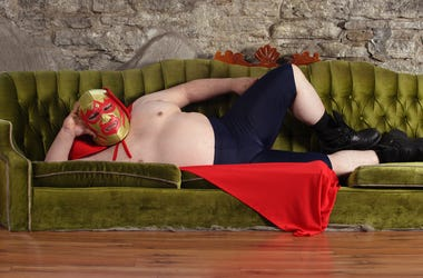 Mexican wrestler lying on a couch