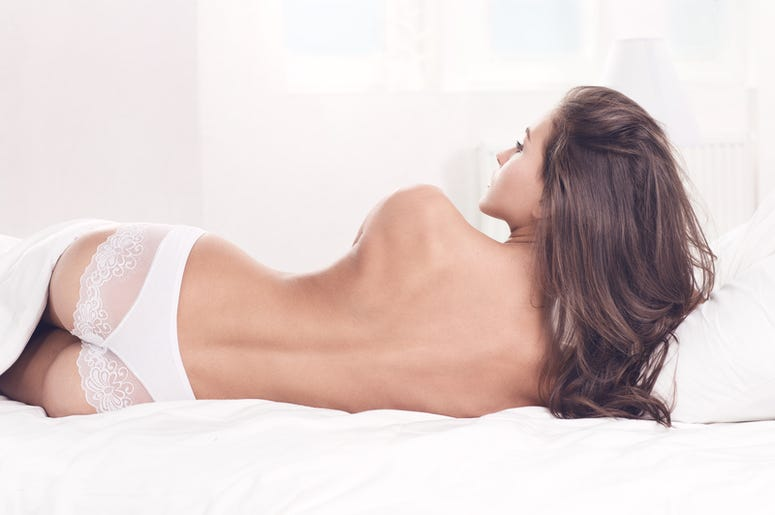 Young woman lying with a bare back