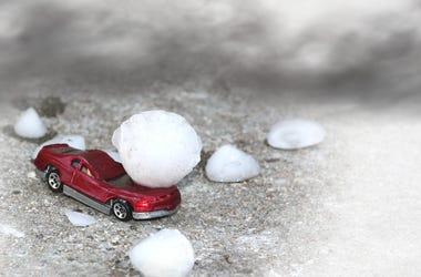 A rd car damaged by large hail