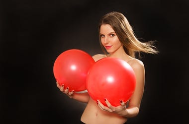 Topless girl playing