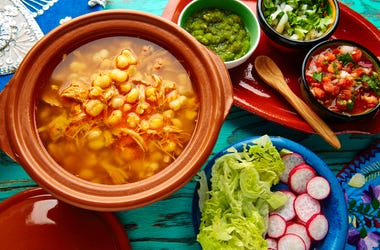 Pozole with mote big corn stew from Mexico. Ingredients, chili.