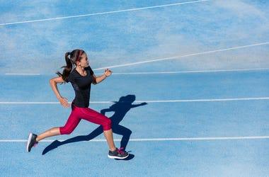 Athlete runner woman running on athletic run track