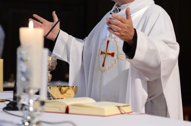 Priest and worship at the altar.