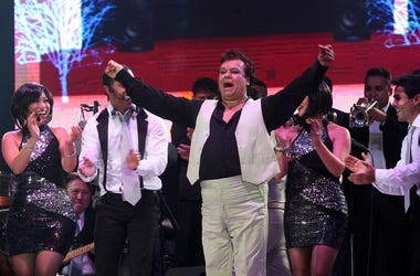 "QUITO, March 14, 2014 (Xinhua) -- Mexican singer and composer, Juan Gabriel (C), performs during a concert of his ""Gracias por cantar mis canciones"" tour, in the Ruminahui coliseum, in Quito, capital of Ecuador, on March 13, 2014. Juan Gabriel is back in"