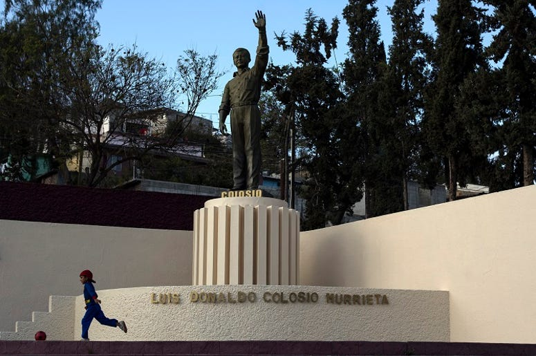 """TIJUANA, March 22, 2014 (Xinhua) -- Image taken on March 21, 2014, shows a statue of the late presidential candidate of the Institutional Revolutionary Party (PRI, for its acronym in Spanish), Luis Donaldo Colosio, placed where he was murdered, in """"Unit a"""