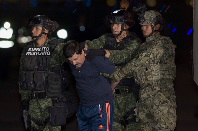 "Soldiers escort Joaquin Guzman Loera, alias ""El Chapo"", upon his arrival to the hangar of the Attorney General's Office, in Mexico City, capital of Mexico, on Jan. 8, 2016. After an early morning raid in northwestern Mexico's Sinaloa State's town of Los"