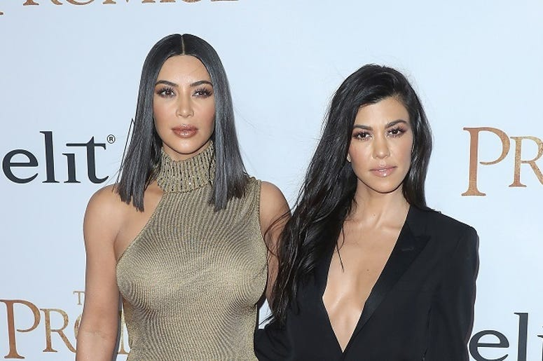 "HOLLYWOOD, CA - APRIL 12: Kim Kardashian and Kourtney Kardashian at the premiere of ""The Promise"" at TCL Chinese Theatre on April 12, 2017 in Hollywood, California."