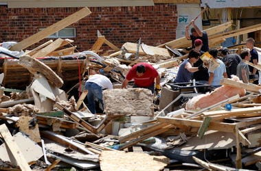 Volunteers help homeowners search through the rubble of their destroyed homes following a tornado on April 4, 2012 in Forney, Texas. Multiple tornadoes touched down yesterday across the Dallas/Fort Worth area causing extensive damage.