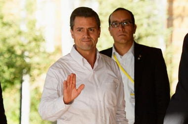 exico's President Enrique Peña Nieto (L) arrives to the Allen & Co. annual conference on July 10, 2013 in Sun Valley, Idaho. The resort will host corporate leaders for the 31st annual Allen & Co. media and technology conference where some of the wealthies