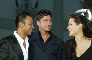 """Actors Simon Yam, Gerard Butler and Angelina Jolie attend the world premiere of the film """"Lara Croft Tomb Raider: The Cradle of Life"""" at Grauman's Chinese Theatre July 21, 2003 in Hollywood, California. The film releases nationwide July 25, 2003."""
