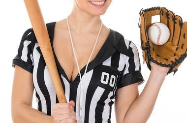Young Beautiful Referee Wearing Baseball Glove And Holding Baseball Bat