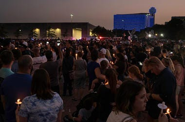 Hundreds of residents show support for the Dallas Police Department at the Dallas Strong Candlelight Vigil on July 11, 2016 in downtown Dallas, Texas. Texas. Five police officers were killed and seven others were injured in a shooting ambush during a marc