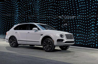 A Bentley Bentayga is shown during a speed test against Faraday Future's FF 91 prototype electric crossover vehicle (not shown) during the FF 91's unveiling at a press event for CES 2017 at The Pavilions at Las Vegas Market on January 3, 2017 in Las Vegas