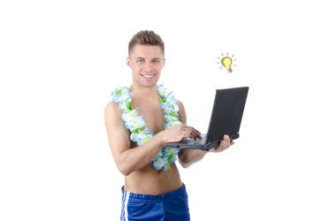 Holiday and relaxation. Work on vacation. Young attractive man holding a laptop. Isolated. White background.