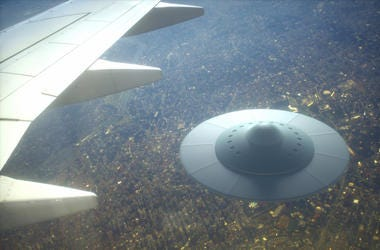 3D illustration with photography. Alien spaceship flying together with airplane.