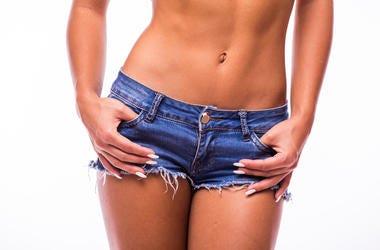 Woman in jeans texas. Studio, skin.