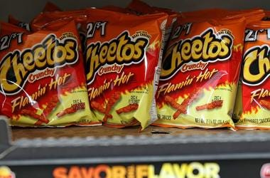 Bags of Cheetos Flamin' Hot Crunchy are displayed for sale at Touchdown Food Mart, September 27, 2012, in Chicago, Illinois.