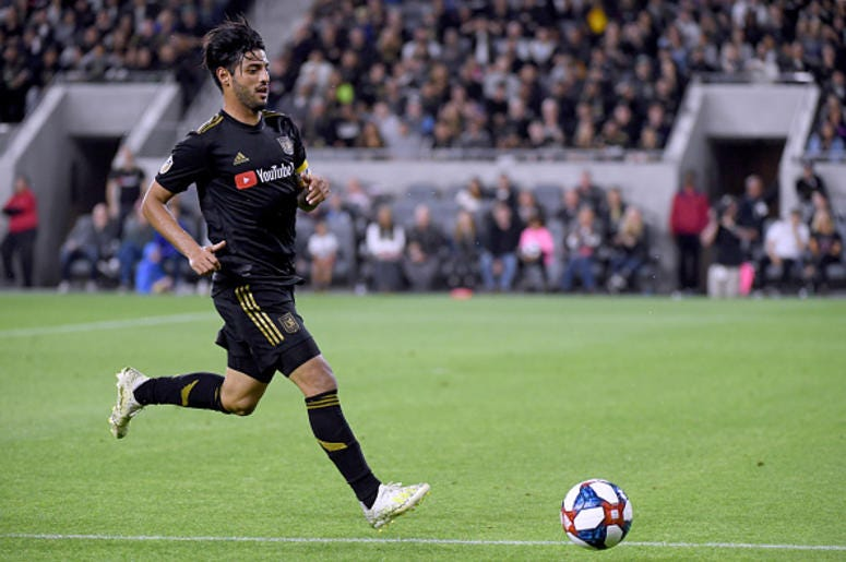 Carlos Vela #10 of Los Angeles FC chases down a ball during a 2-0 win over FC Cincinnati at Banc of California Stadium on April 13, 2019 in Los Angeles, California.